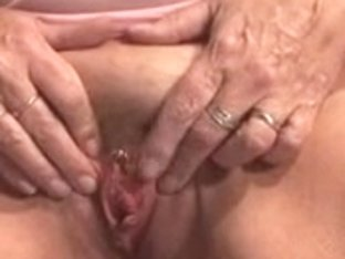 Granny shows her cum-hole and plays alone on couch
